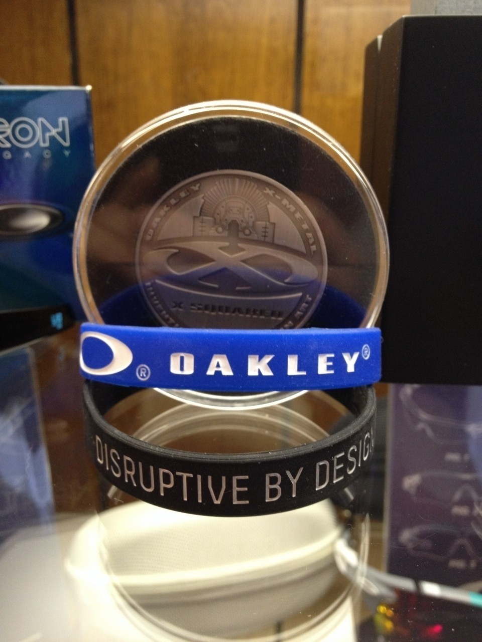 X Squared Coin<br /> Oakley band from Lenscrafters<br /> Disruptive By Design band
