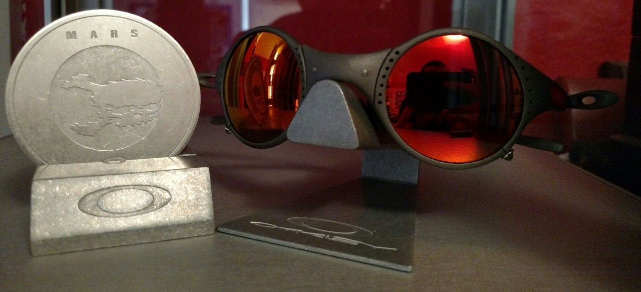 X Metal frame with custom cut Ruby Iridium lens and red Linegear rubber.